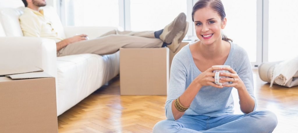 woman man boxes apartment moving